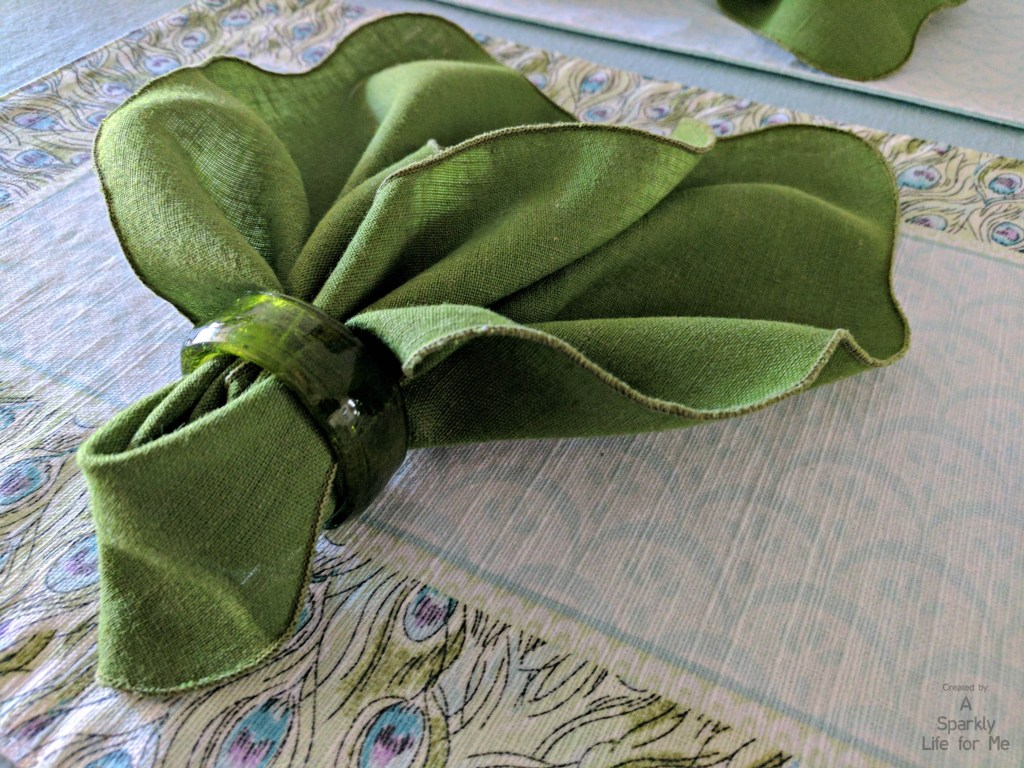 Green Leaf Napkin Fold on Peacock Place Mat