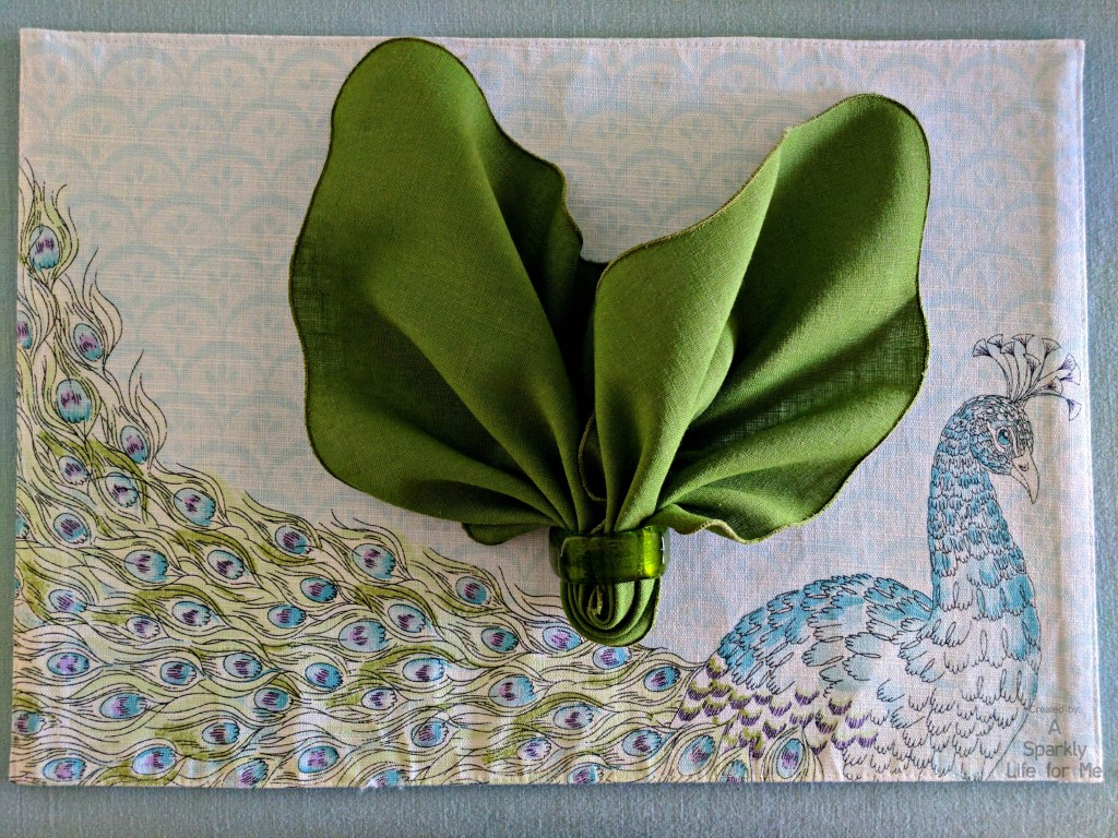 Modern Peacock Place Mat with Green Leaf Napkin Fold