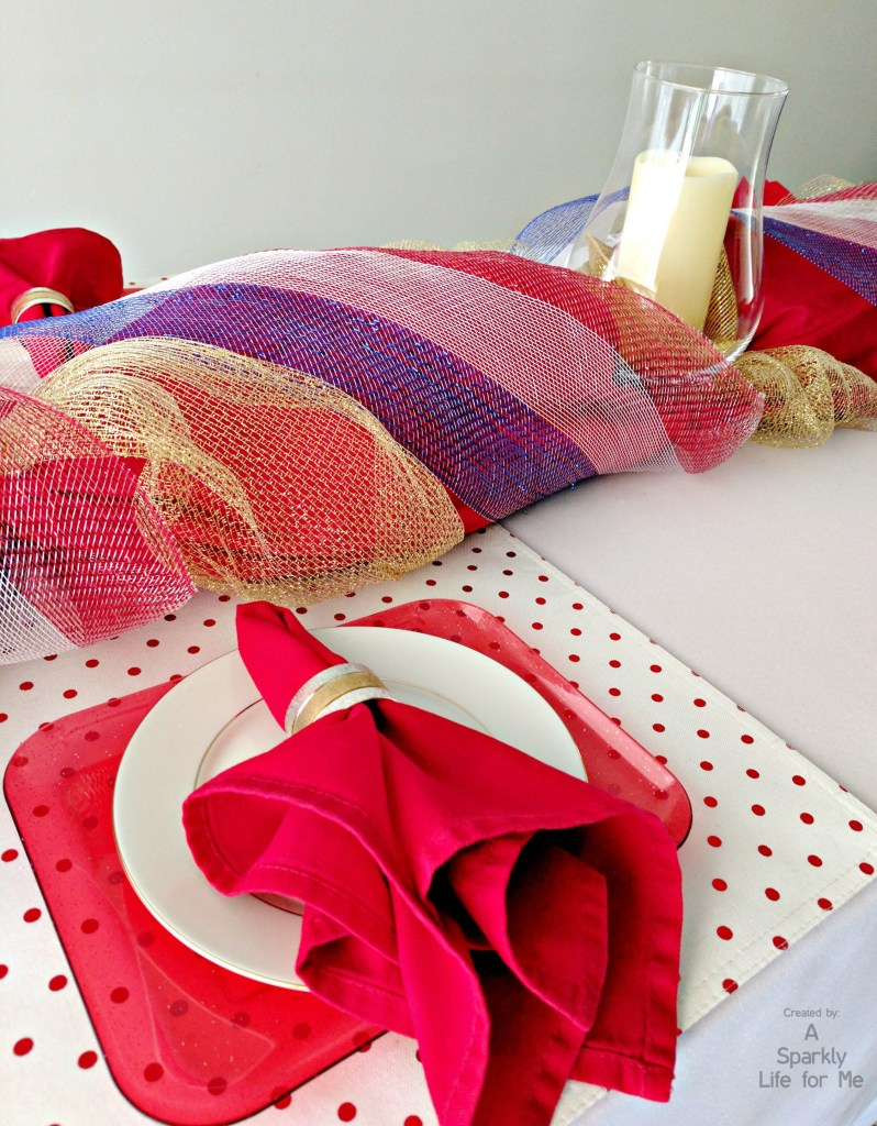 Fancy patriotic garland table decor in red white and blue with gold ribbon and decor mesh
