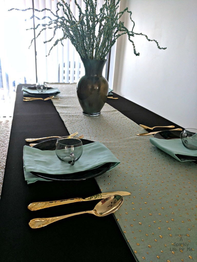 Table Decor in Gold Black and Blue with Gold Flatware