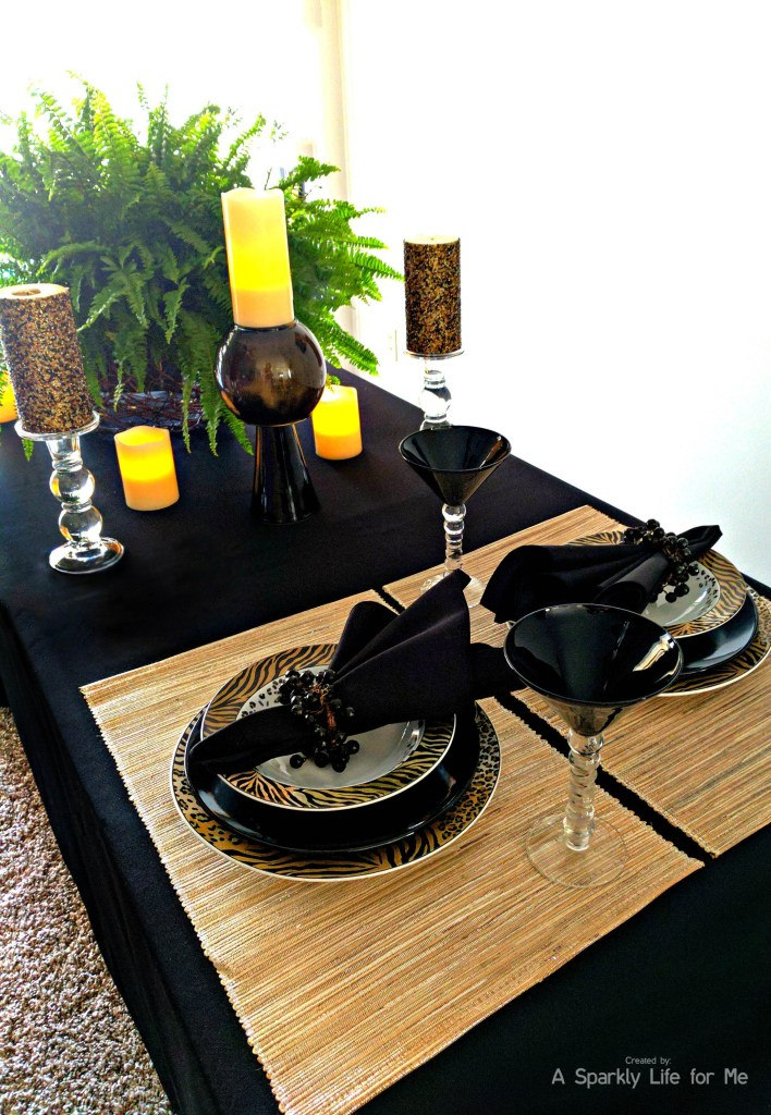 Fancy jungle and animal print table decor with DIY black and gold marble feature vase with LED candle accents