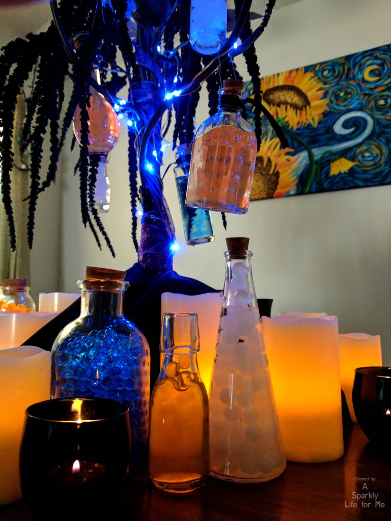 DIY Glowing Potion Tree close up of LED candles and potions - by A Sparkly Life for Me