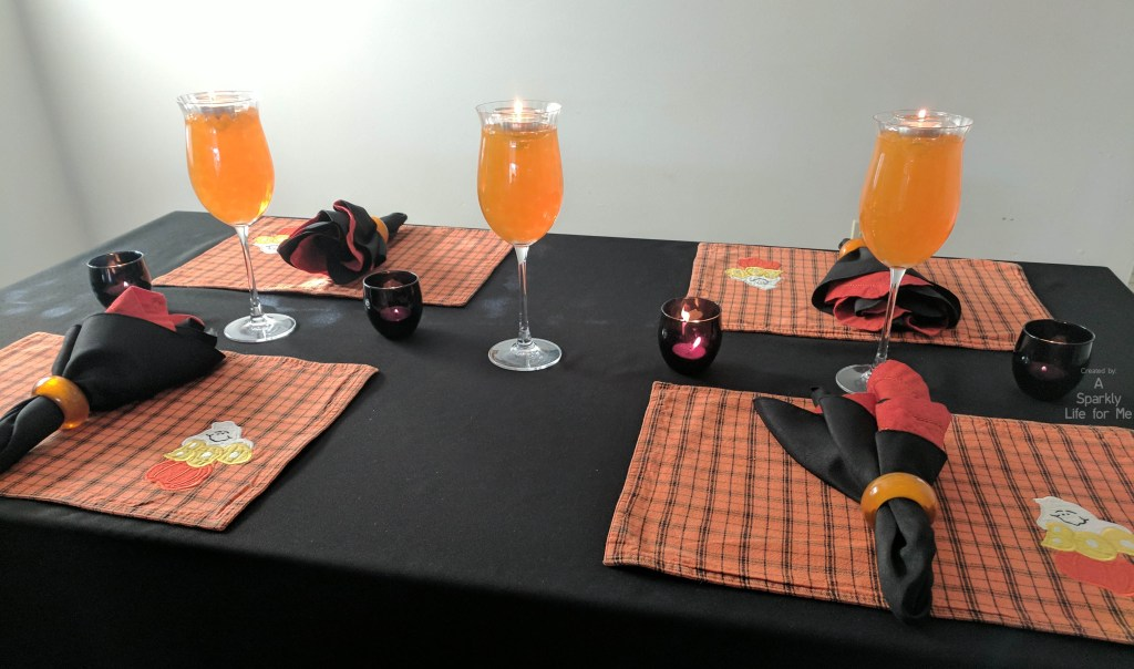 Black and orange halloween table decor with gel beads with thrift store decor by A Sparkly Life for Me