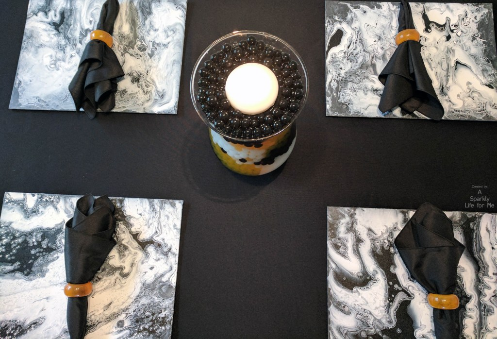 Top down view of a DIY fluid acrylic tablescape for halloween by A Sparkly Life for Me