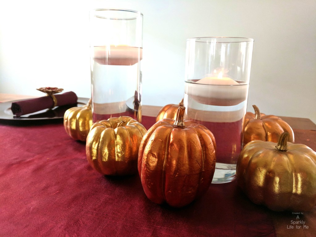 Metallic pumpkin with floating candle table decor for thanksgiving by A Sparkly Life for Me
