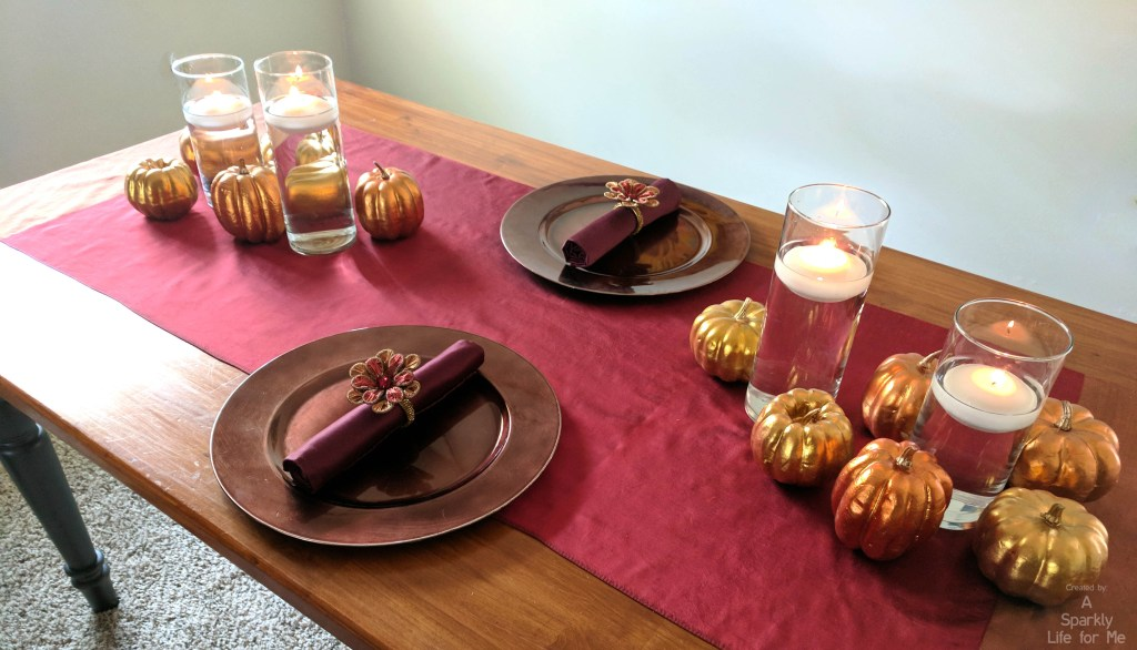 Thanksgiving table with mini faux pumpkins and accents from the thrift store by A Sparkly Life for Me