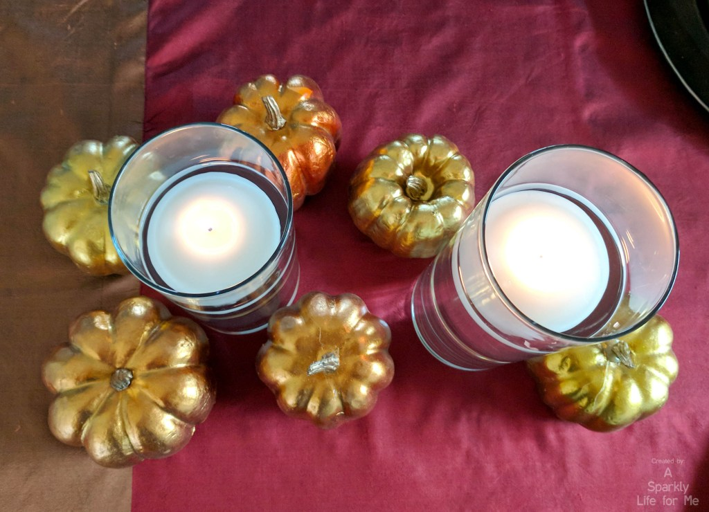 Top down metallic pumpkin and floating centerpiece table decor by A Sparkly Life for Me