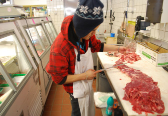 Govany Hernandez, of Carbondale, slices meat at Garcia's market in New Castle, serving the tastes of a Hispanic population that grew boomed across the valley. In Carbondale, Hispanics make up nearly 40 percent of the population, according to the 2010 census.