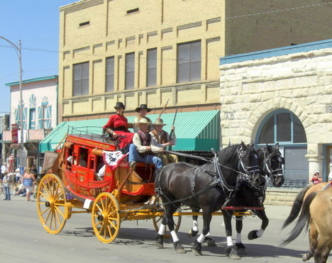 A pristine stagecoach from Bear Ranch in Paonia's Cherry Days Parade on July 4, 2011. Bill Koch is in the front seat of the stage, next to the driver, and holding a rifle.