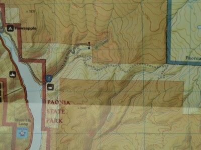 This photo of a map shows the Paonia Reservoir, Gunnison County Road 2 that runs up to the east of the reservoir, and the road across the BLM land between the private land (shaded) owned by Bear Ranch. Just before the BLM road ends, there is a bend in the road right at the corner of U.S. Forest Service land. At that point, there is a rough trail that follows Deep Creek up the hill, where it eventually connects with  a well-established wilderness trail leading into upper Deep Creek.