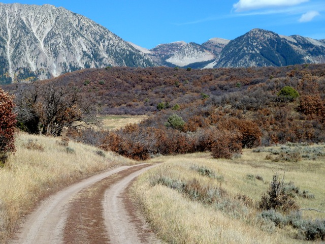 This is the road that winds through a parcel of BLM land that splits Bill Koch's Bear Ranch east of Paonia Reservoir. He would like to trade the BLM land for other federal land in Colorado and Utah. Peaks on public land in the Raggeds Wilderness are visible in the background.