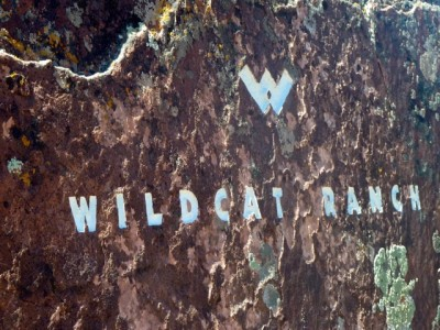 The sign at the entrance to Wildcat Ranch, where several billionaires own homes.