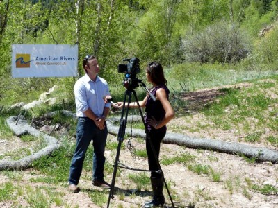 Matt Rice, director of conservation in Colorado for American Rivers, being interviewed by Danielle Kreutter of KREX-TV in Grand Junction after a May 14 press conference on the banks of the Crystal River.