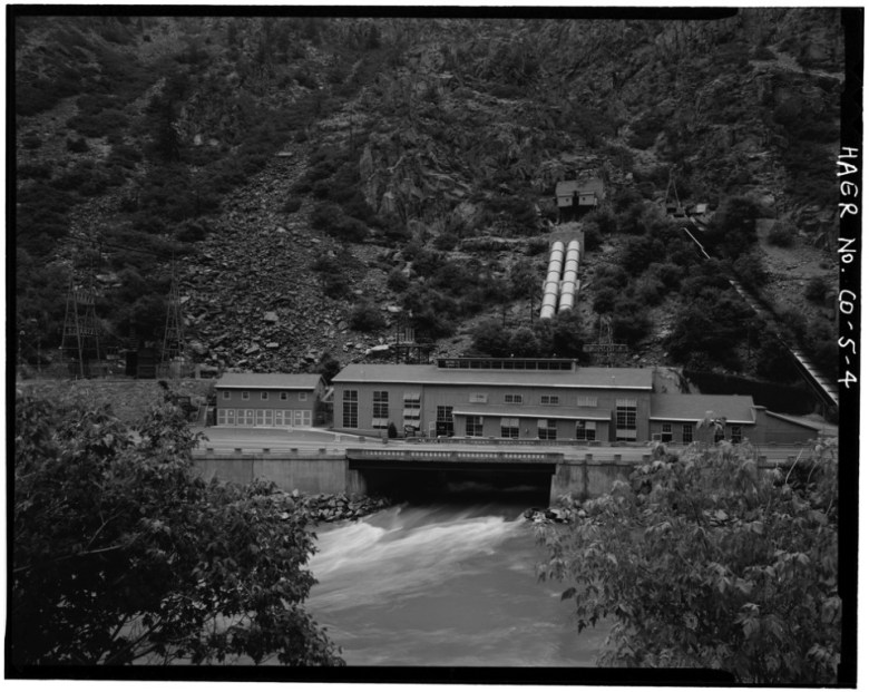 A historic photo of the Shoshone hydro plant, with U.S. 6 instead of I-70 in front of it. The plant, which opened in 1909, carries senior water rights from 1902 for 1,250 cfs. The water right now dominates the flow regime in the Colorado River.