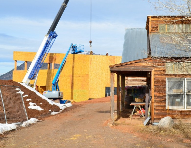 A new Aspen Community School gymnasium rises adjacent to the existing wood shop on the Woody Creek campus.