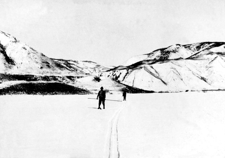 Two skiers in an open area between Castle Creek and Maroon Creek, circa 1900.