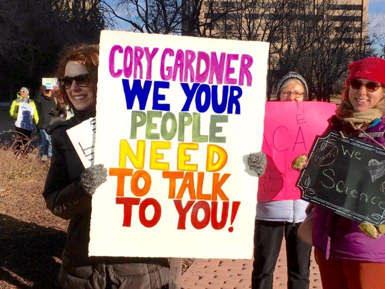Protestors holding signs outside of the Hyatt Regency hotel on Jan. 27, 2017, hoping to meet with Sen. Gardner.