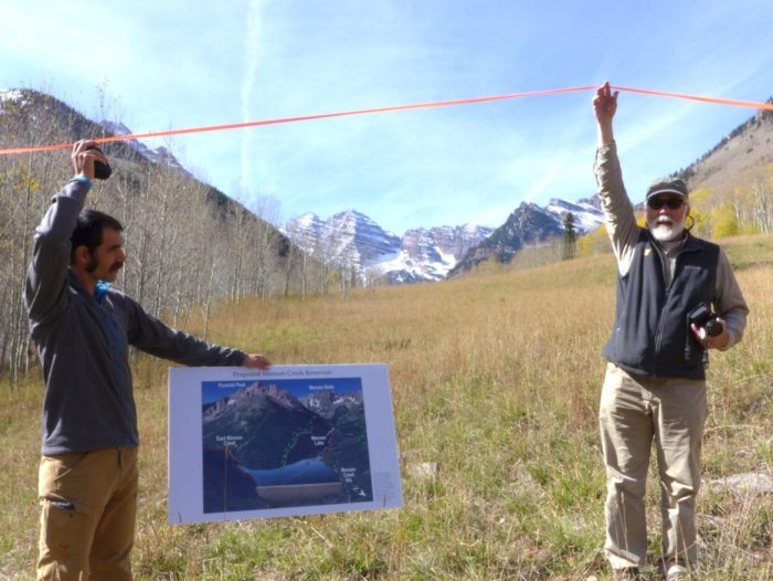 Will Roush, left, of Wilderness Workshop, and Ken Neubecker, right, of American Rivers, hold up tape on Sept. 7 showing where the base of a 155-foot-tall dam would be located on Maroon Creek if the City of Aspen were to build a reservoir tied to one of its conditional water rights. Wilderness Workshop and American Rivers were two of ten parties who filed statements of opposition by Dec. 31 in two water rights cases the city is pursuing.