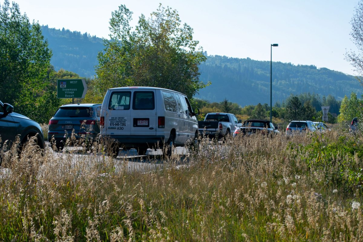 Afternoon rush-hour traffic at Aspen's roundabout as cars leave town, driving downvalley on Highway 82.