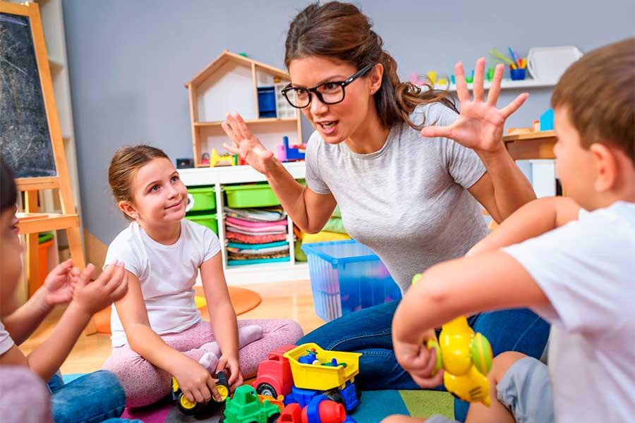 A preschool teacher engages a group of children