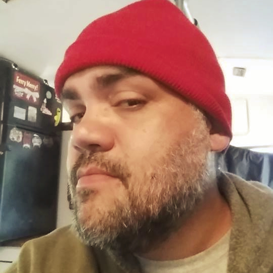 Mike with red had, beard.