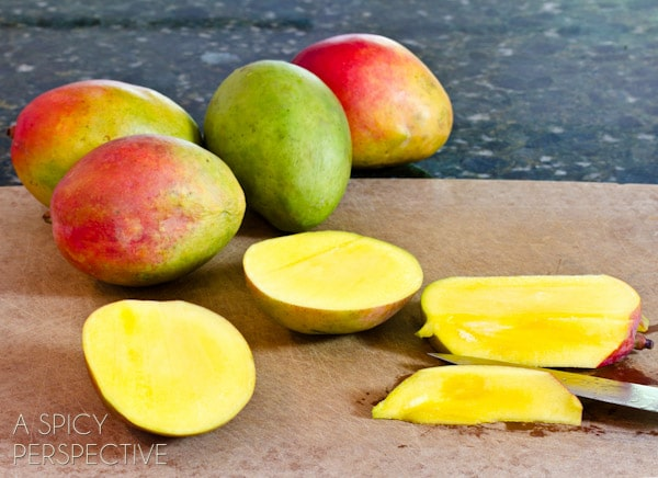 How to Cut a Mango - Pit | ASpicyPerspective.com #howto #cookingtips #mango
