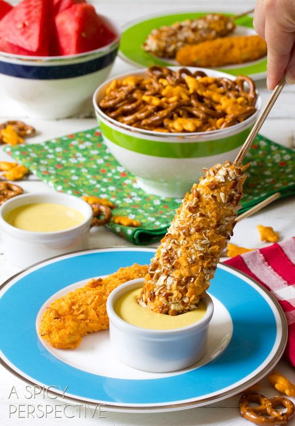 Easy Cheesy Pretzel Chicken Pops with Honey Mustard Sauce   ASpicyPerspective.com #kidfriendly #chickentenders #backtoschool #recipe