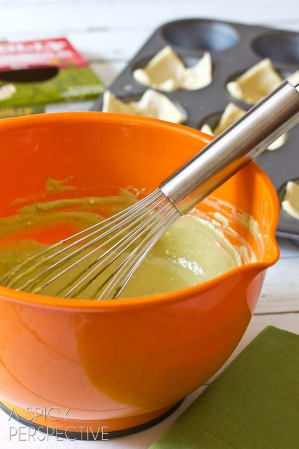 Making Guacamole Mini Quiche Recipe - Perfect for Brunch! ASpicyPerspective.com #brunch #quiche #miniguac #guacamole