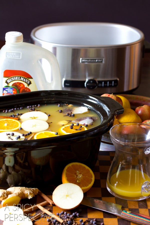 Making #SlowCooker Wassail Recipe (Mulled Cider) ASpicyPerspective.com #fall #apple #party #recipe