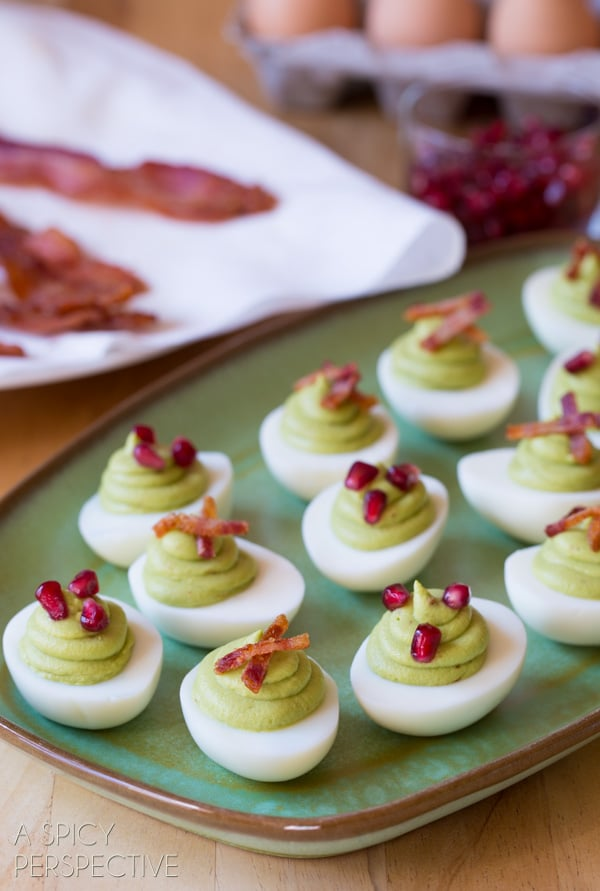 Easy Avocado Deviled Eggs topped with #Bacon and #Pomegranate! #deviledeggs #easter #avocado