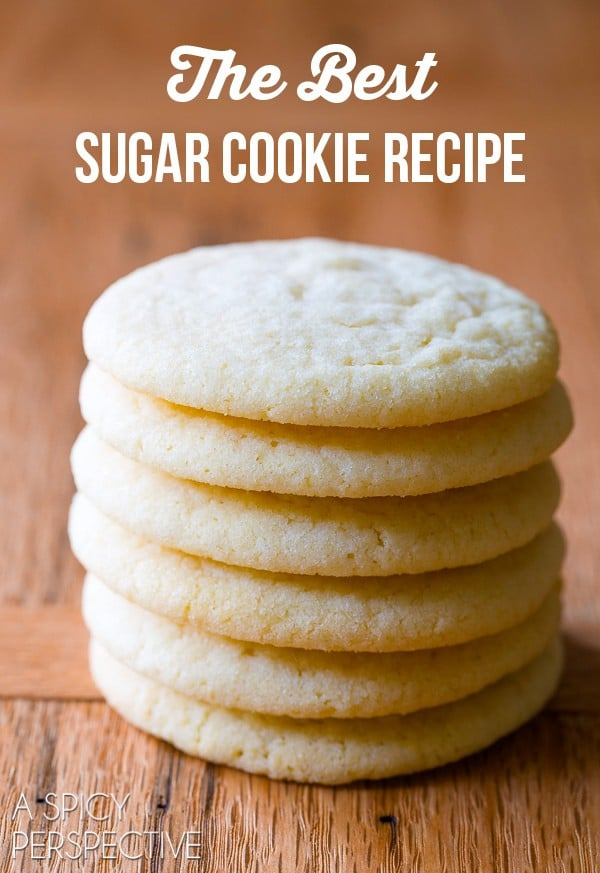 Hands down, the Best Sugar Cookie Recipe we've ever tested! Learn How to Make Sugar Cookies that everyone will love. Light, pillowy, & packed with flavor. #ASpicyPerspective #cookies #sugarcookie #baking #dessert