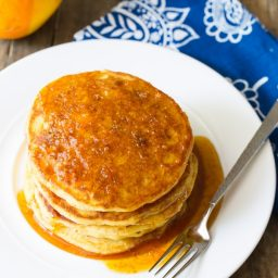 Cornmeal Pancakes with Orange Syrup on ASpicyPerspective.com #breakfast #pancakes