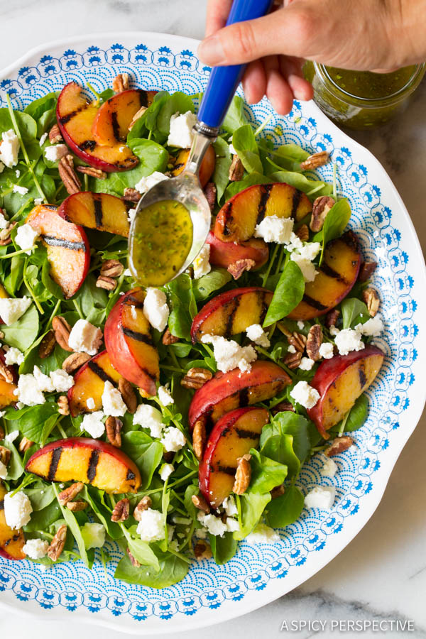 The Best Grilled Peaches and Watercress Salad with Basil Vinaigrette on ASpicyPerspective.com #salad #peaches