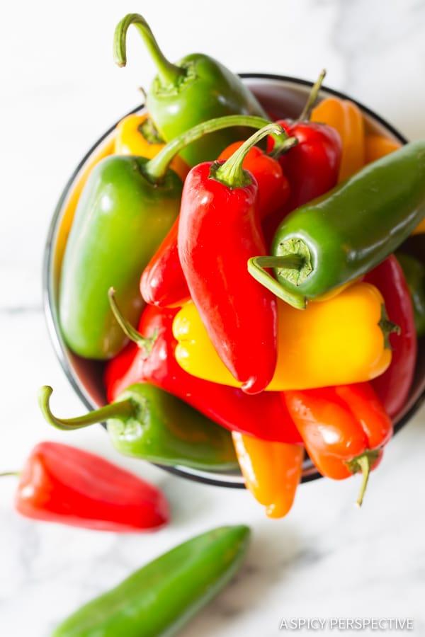 Making 3-Ingredient Mini Stuffed Peppers Recipe on ASpicyPerspective.com - So good!