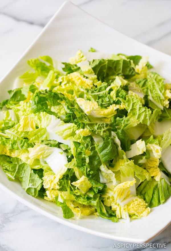 Making Crunchy Napa Cabbage Salad with Mango and Toasted Almonds on ASpicyPerspective.com