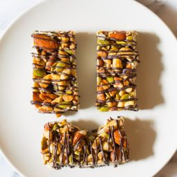 Awesome Kid-Friendly Paleo Nut Bar Recipe with Chocolate Drizzle on ASpicyPerspective.com #paleo #vegan #glutenfree