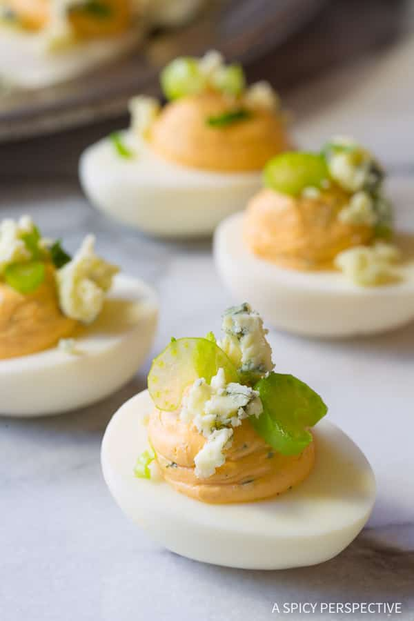 Love these Buffalo Ranch Deviled Eggs Recipe | ASpicyPerspective.com