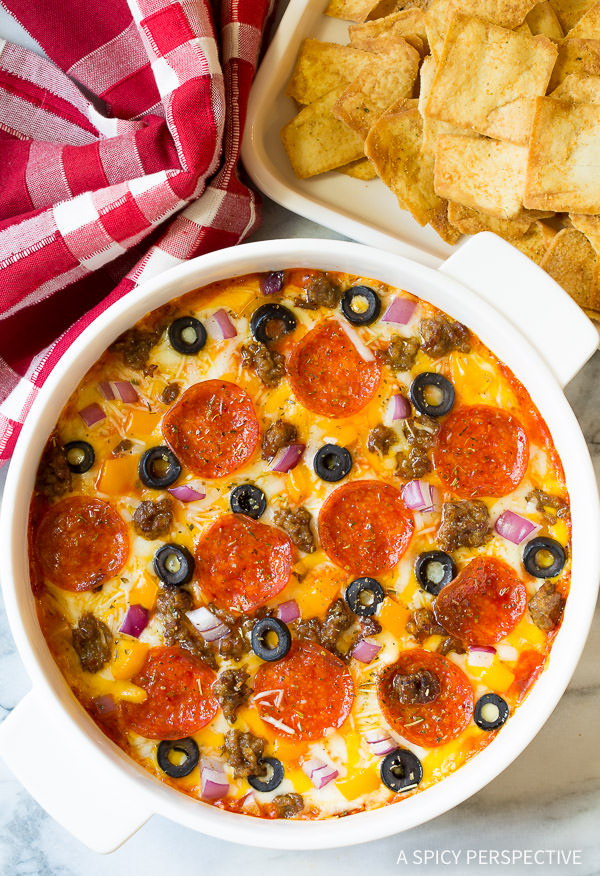 The BEST Supreme Pizza Dip - Perfect for Super Bowl and can be made in the slow cooker!   ASpicyPerspective.com