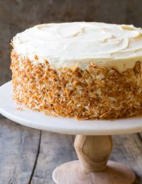 Carrot Cake Recipe #ASpicyPerspective #CarrotCake #Cake #Carrots #CarrotCakeRecipe #BestCarrotCakeRecipe #Dessert #Coconut #CreamCheeseFrosting #Easter #Spring