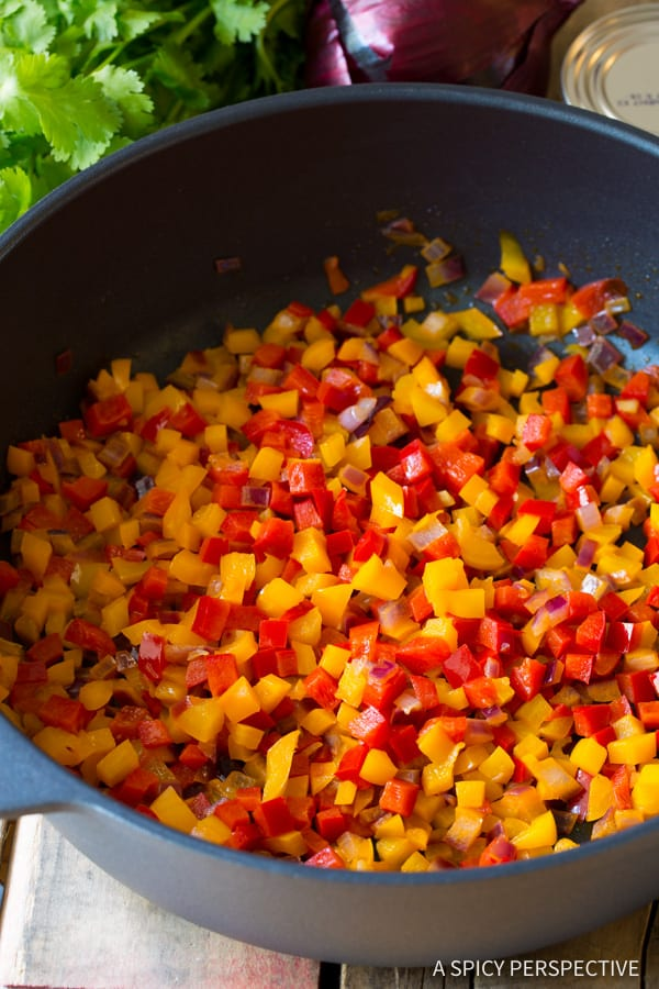 Bell Peppers and Onions #ASpicyPerspective #Rice #Caribbean #CaribbeanRice #CaribbeanRiceRecipe #ConfettiRice #SideDish #Jalapenos #Pineapple #BellPeppers #CoconutMilk