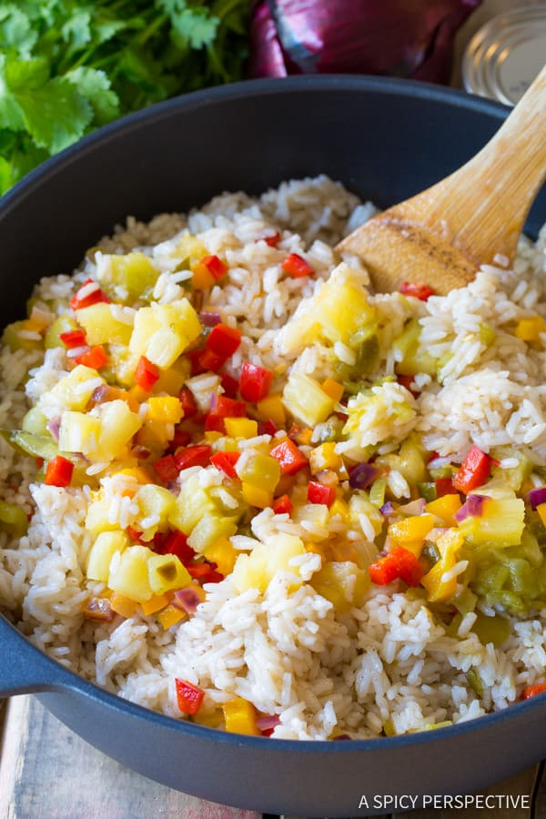 Confetti Rice #ASpicyPerspective #Rice #Caribbean #CaribbeanRice #CaribbeanRiceRecipe #ConfettiRice #SideDish #Jalapenos #Pineapple #BellPeppers #CoconutMilk