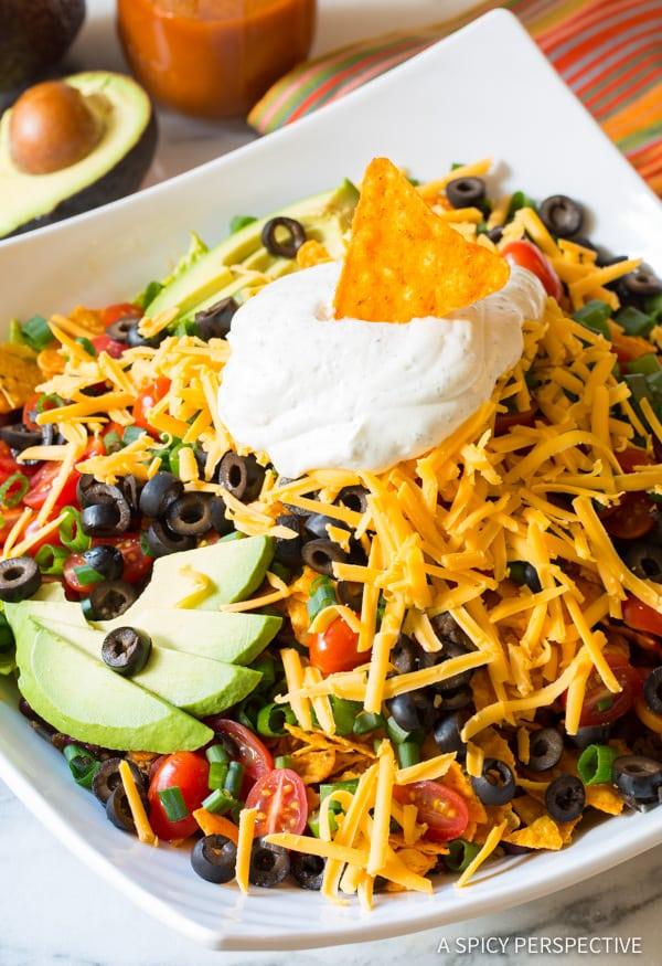 Dorito Taco Salad #ASpicyPerspective #TacoSalad #TacoSaladRecipe #DoritoTacoSalad #DoritoTacoSaladRecipe #Doritos #TacoSaladDressing #HowtoMakeTacoSalad #TacoSaladIngredients #Salad