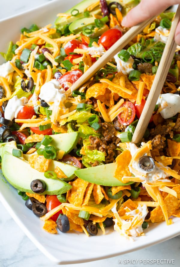 Serving Taco Salad #ASpicyPerspective #TacoSalad #TacoSaladRecipe #DoritoTacoSalad #DoritoTacoSaladRecipe #Doritos #TacoSaladDressing #HowtoMakeTacoSalad #TacoSaladIngredients #Salad