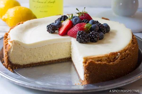 Limoncello Cheesecake with Biscoff Crust #ASpicyPerspective #Cheesecake #HomemadeCheesecake #Limoncello #LimoncelloCake #LimoncelloCheesecake #Biscoff #BiscoffCookie #CookieCrust #Dessert