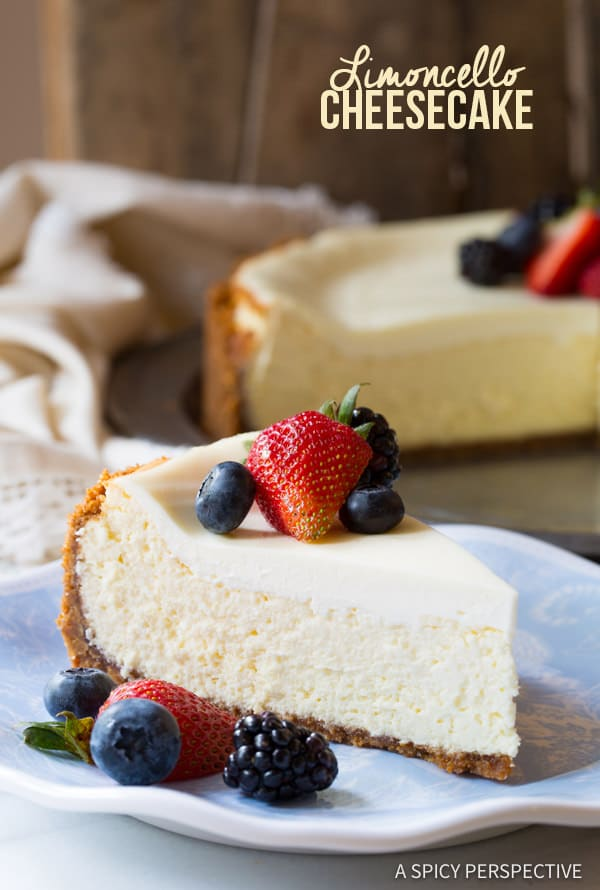 Limoncello Cheesecake #ASpicyPerspective #Cheesecake #HomemadeCheesecake #Limoncello #LimoncelloCake #LimoncelloCheesecake #Biscoff #BiscoffCookie #CookieCrust #Dessert