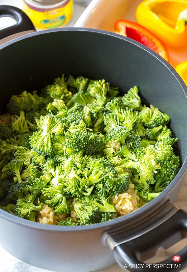 Broccoli Rice #ASpicyPerspective #StuffedPeppersRecipe #StuffedPeppers #VegetarianStuffedPeppers #StuffedPepperswithRice #HealthyStuffedPeppers #BroccoliRice #Cheese #Broccoli #Rice #Vegetarian