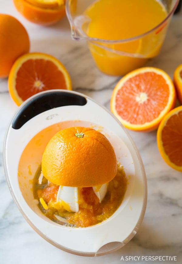 Juicing Oranges #ASpicyPerspective #Orangeade #OrangeadeRecipe #Orange #Summer #Southern #Beverage #Drink