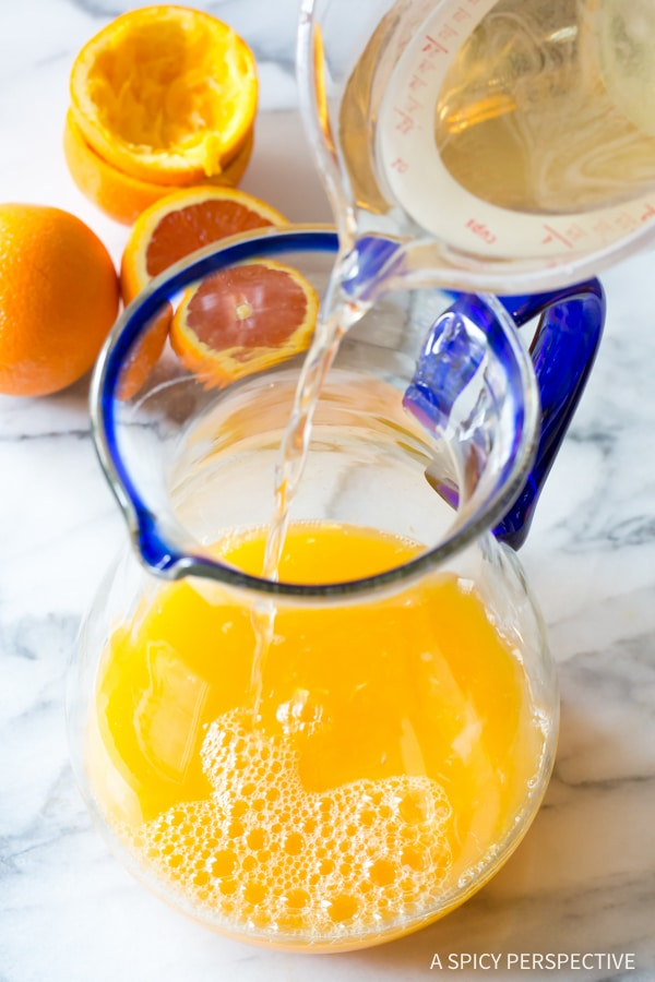 Adding Simple Syrup #ASpicyPerspective #Orangeade #OrangeadeRecipe #Orange #Summer #Southern #Beverage #Drink