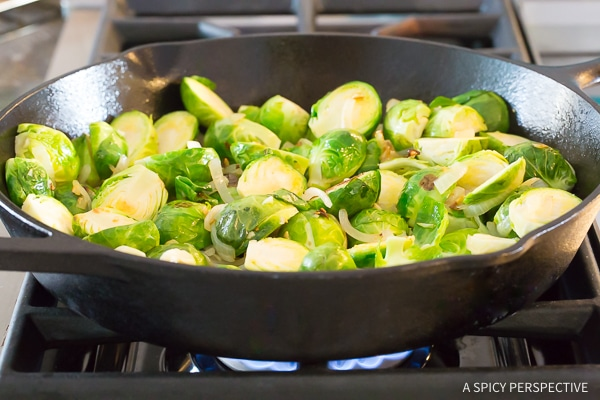 Braised Brussels Sprouts with Sun-Dried Tomatoes, Artichokes, and Olives