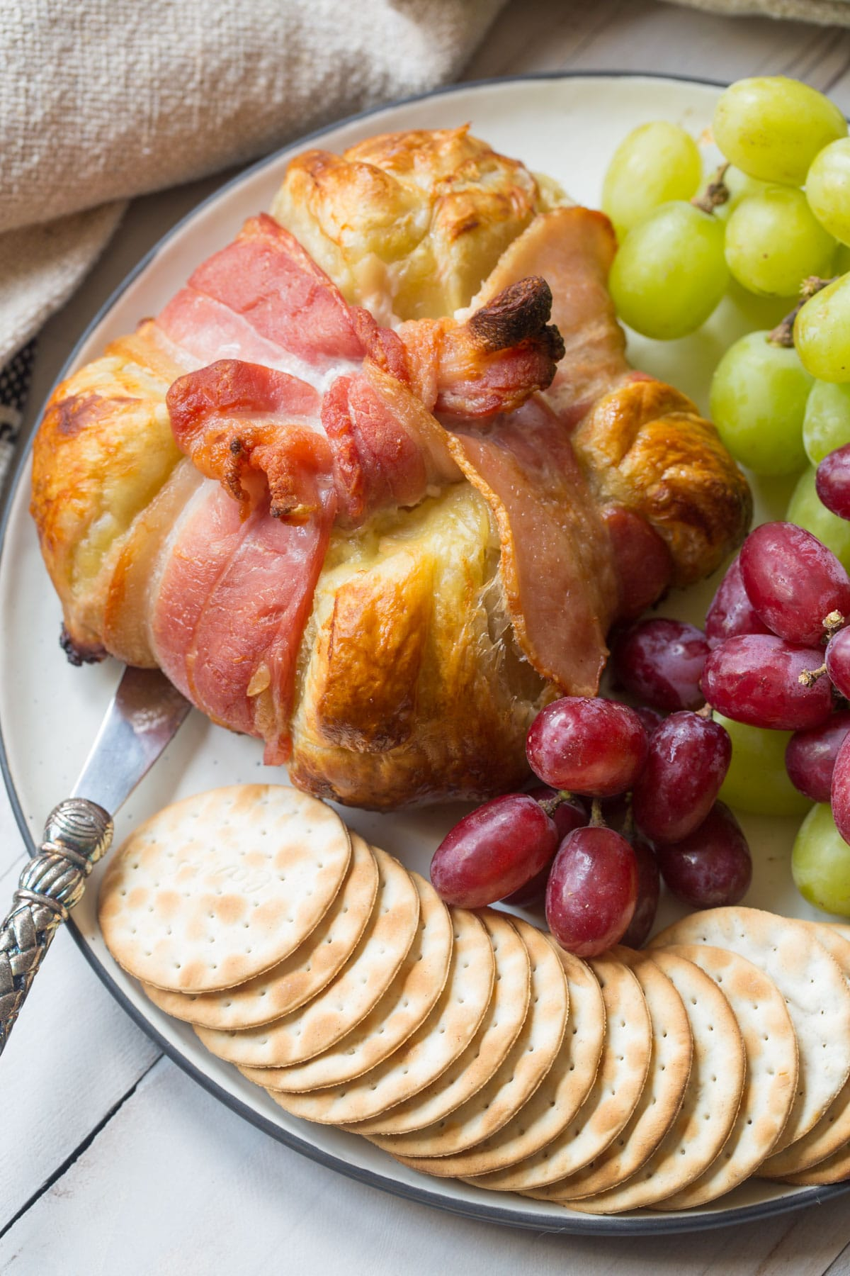 Easy Baked Brie in Puff Pastry Recipe #ASpicyPerspective #bakedbrie #holidays #christmas